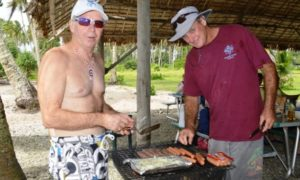 Allen and Cary tend the barbie at Enemanet. Photo: Karen Earnshaw