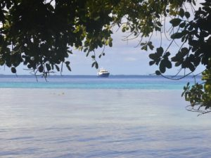 The motor vessel Reel Dreams pulls into Enemanet Island in early March, 2018 and prepares to pick up a yacht club buoy. Photo: Karen Earnshaw
