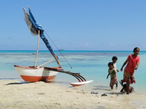 Children with their on mini-canoe at Ailuk Atoll. Photo: Karen Earnshaw